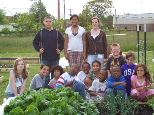 Monroe County youth show off the fruits (and vegetables) of their labor.
