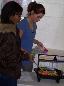 Youth making a vegetable stir fry