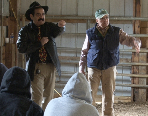Juan Marinez and Ben Bartlett teach cattle handling techniques.