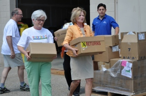 Retired MSUE associate director Cheri Booth and senior associate provost June Youatt help load books