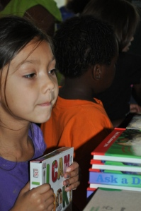 A child chooses a book at the book give-away.
