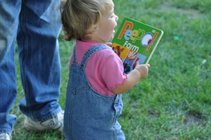 Toddler enjoys her new book