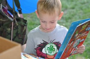 Young 4-H'er chooses a book