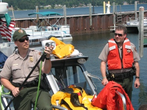 Park rangers demonstrate personal flotation devices.