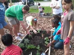 Grand Rapids Junior Master Gardener students and parents plant an herb garden.