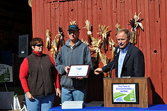 Keith Creagh (right), MDARD director, honored MAEAP-verified farmer Larry Lee (middle) and Annette Lee (left) Oct.17, 2011.