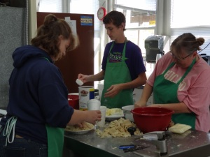 4-H Volunteers prepare the topping