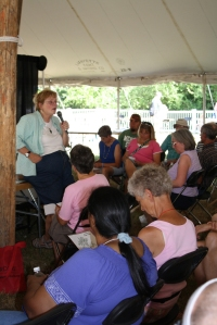 Extension educator Gretchen Voyle speaks to an attentive audience at Ag Expo about protecting tomatoes from four major diseases