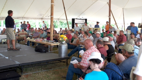 A standing-room-only crowd listens to a session at Ag Expo in the CANR Tent July 2012, East Lansing, Mich.