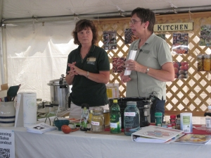 MSU Extension educators Joyce McGarry (left) and Lindy Huyck prepare to demonstrate canning methods