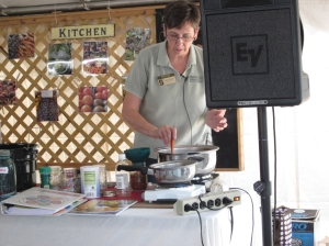 MSU Extension educator Linda Huyck stirs salsa during a salsa canning demonstration