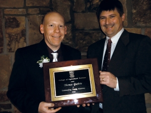 MSU Extension educator Tom Guthrie (left) receives the SIU at Carbondale, College of Agricultural Sciences, 2013 Outstanding Young Ag Alumnus award Feb. 22, 2013. Dr. Gary Apgar (right) nominated Tom for this honor.