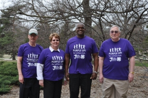 Michigan State University (MSU) Extension colleagues support military kids on PURPLE Up! Day, April 15, 2013. Left to right: MSU Extension director Tom Coon, director of MSU Extension Children and Youth Institute Julie Chapin, Michigan 4-H Youth Development associate program leader B'Onko Sadler and MSU Extension associate director Steve Lovejoy. Photo credit: Katie Gervasi