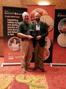Tom Kalchik, associate director of the MSU Product Center, (left) accepts the First Place MarketMaker Innovation Award