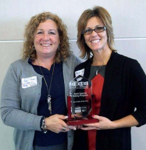 Kent Special Riding Program (KSRP) instructors Amy Plets (left) and Jackie Foster accept KSRP's WGVU Engage I HAVE Made a Difference award for nonprofit of the year, Nov. 8, 2013, at Grand Valley State University.