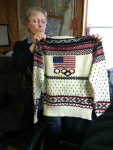 On Jan. 20, 2014, Debbie McDermott of Stonehedge Fiber Mill in East Jordan, Mich,, holds up one of the sweaters to be worn by Team USA in the 2014 Winter Olympics. The mill prepared the yarn for the Olympic sweaters and hats designed by Ralph Lauren.