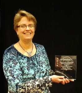 "Betsy Greene, University of Vermont Extension specialist and associate professor, accepted the ""Community of Practice Individual Achievement Award"" on behalf of  Michigan State University Extension specialist Karen Waite at the National eXtension Conference"