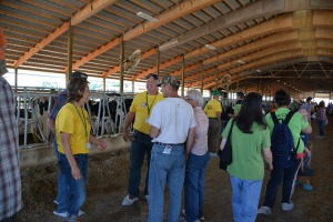 Richard and Dawn Myers (in yellow shirts) answer attendees' questions at the Calhoun County Breakfast on the Farm (BOTF), July 19, 2014