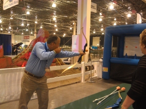 Patrick Cudney, MSU Extension associate director, tests his skill at hoverball archery