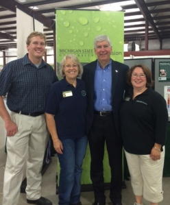 left to right:  Rep. Ed McBroom (108th district); Nancy Victorson, Michigan State University senior Extension educator ‒ Luce County; Gov. Rick Snyder; Michelle Walk, MSU Extension educator ‒ Chippewa County