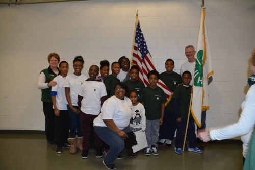 Jeff Dwyer and Julie Chapin with the 4-H Ingham County group with the 4-H flag and US flag.