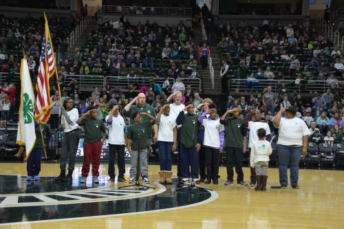 Picture of Ingham County 4-H and Jeff Dwyer at the center of the court during half time to lead the 4-H pledge.