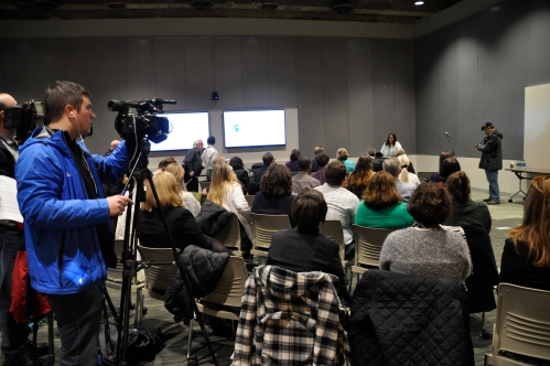 Photo of announcement by Dr. Mona Hanna-Attisha of the Pediatric Public Health Initiative to a room filled with partners, media and government officials.