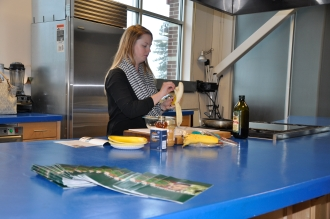 Photo of a Cooking demonstration at the Eastern Market using ingredients that are high in iron, calcium and Vitamin D.