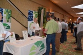 Photo of the trade show with vendors speaking with conference attendees at their booths.