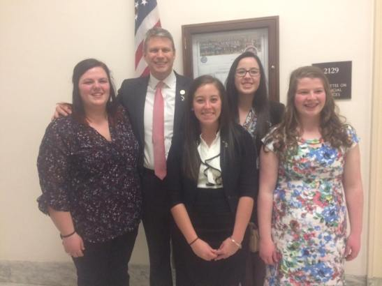 MSU 4-H youth Samantha Beaudrie, Katie Kurburski, Katelyn Stevens and Emma Young pose for a photo with Congressman Huizenga.