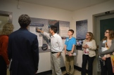 Participants look at a poster explaining robotic fish.