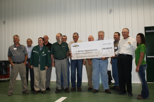 The Michigan Wheat Program board of directors presents a check to Michigan State University during the announcement of their donation.