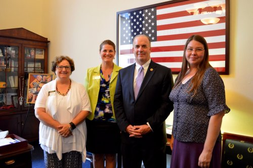 Holly Tiret, Jodi Schulz and Julie Crick pose for a picture with Representative Dan Kildee.
