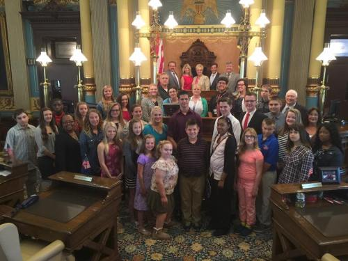Oakland County 4-H youth and leaders pose for a photograph at the State Capitol with Senate Majority Floor Leader Mike Kowall and Rep. Kathy Crawford to celebrate their achievements. Photo courtesy of Oakland County 4-H.