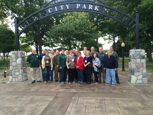 State Council members and administrators pose for a group photograph in downtown Cadillac.