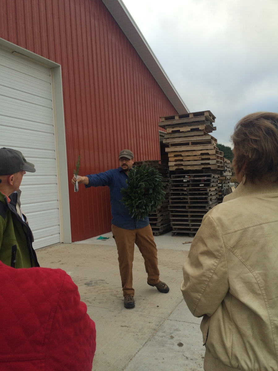 State council members hear from the owner and his son-in-law of Dutchman Tree Farms after an introduction of the Christmas Tree Industry by Jill O'Donnell.