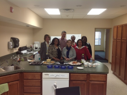 State Sen. John Proof poses for a picture with Extension staff in the kitchen at the Berrien County office.