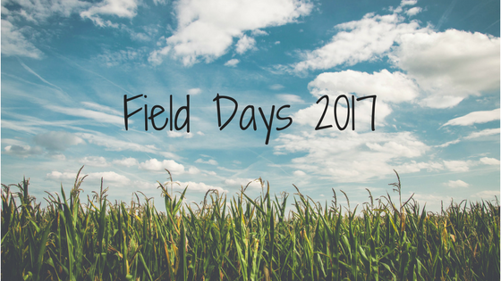 A corn field with blue sky and clouds. The image text reads: Field Days 2017.