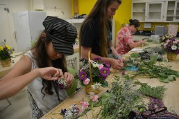 Students putting together bouquets during a session.