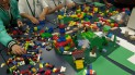 Youth build a town with legos.
